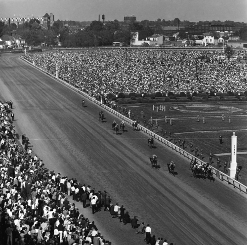The Kentucky Derby field of 15 horses appeared strung out up the home stretch like this as Kauai King won the race, May 7, 1966 in Louisville, Kentucky. (AP Photo)