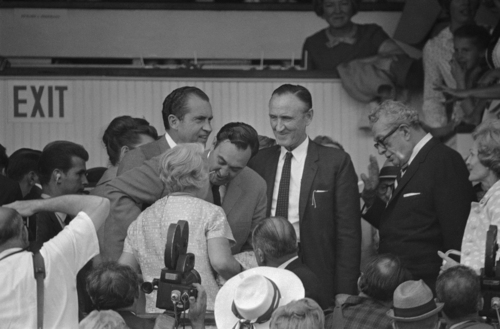 Sen. Everett Dirksen, right, raises his hand as Gov. Louie Nunn of Kentucky bends to kiss Mrs. Dirksen, when they joined President Richard  Nixon in a spectator box at Churchill Downs in Louisville, Kentucky on May 3, 1969 to watch the 95th running of the Kentucky Derby.  Sen.  Mike Mansfield, Senate Majority Leader, takes in the scene standing to the right of Nixon.   (AP Photo)