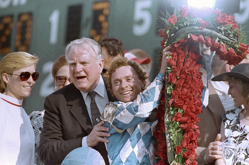 Jockey Chris McCarron holds the roses after winning Saturday's Kentucky Derby aboard Alysheba.   At left is owner Charles Scharbauer shown on May 2, 1987 in Louisville. (AP Photo)