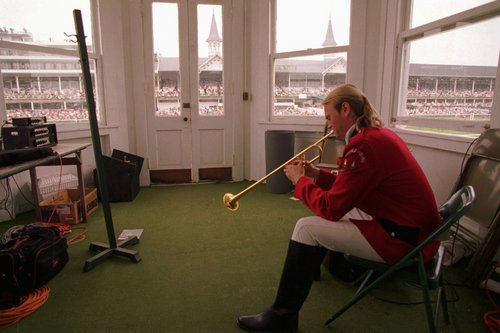 Churchill Downs bugler James Monroe practices his call to the post in the infield pagoda at Churchill Downs May 6, 1995 in Louisville, Ky. Monroe's big event of the day is the 121st running of the Kentucky Derby. (AP Photo/Mike Fisher)