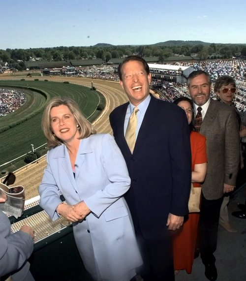 Vice president Al Gore and his wife Tipper pause in the stands during derby day activities prior to the 125th running of the Kentucky Derby, Saturday, May 1, 1999, in Louisville, Ky. (AP Photo/Charles Bennett)