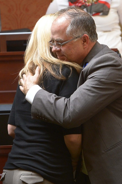 Leah Hogsten  |  The Salt Lake Tribune Nannette Wride receives a hug from bill co-sponsor Rep. David Lifferth in the House chambers after the legislators voted to rename SR-73 to the Cory B. Wride Memorial Highway in Utah County, Wednesday, March, 12, 2014 in honor of Nannette husband who was killed during a shootout along the highway in January.