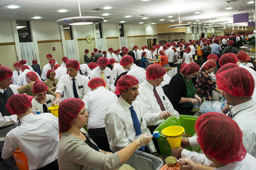 Chris Detrick     The Salt Lake Tribune Mormon missionaries work at preparing meals at the Missionary Training Center in Provo Thursday November 28, 2013.  The 1,800 missionaries spent Thanksgiving by preparing 350,000 meals for hungry Utah children. The packages of nutritious, nonperishable food will be provided to Utah schools where they are sent home with children in need.