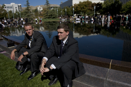Kim Raff | The Salt Lake Tribune LSD missionaries (left) Elder Tyler McCord and Elder Devin Duke sit by the reflecting pool at Temple Square during the 183rd General Conference of the LDS Church in Salt Lake City, Utah on October 7, 2012.