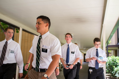 """Trent Nelson     The Salt Lake Tribune Missionaries at the LDS Missionary Training Center in Provo Tuesday June 18, 2013. Every missionary is assigned a """"companion"""" of the same gender, and must stay with that companion at all times. Thus, they almost aways can be seen in pairs."""