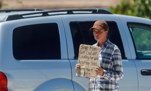 Miranda, a young woman panhandling on the sidewalk in front of the Valley Fair Mall in West Valley City, Utah on Wednesday, July 18, 2012.