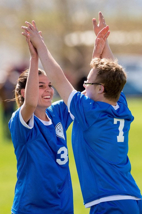 Trent Nelson     The Salt Lake Tribune Bingham's Josh Rothey celebrates a goal with Carly Boiteux in a game vs. Jordan High School in Sandy, Wednesday April 23, 2014. In Unified Soccer, high school athletes who have intellectual disabilities team with partners in 5-on-5 games.