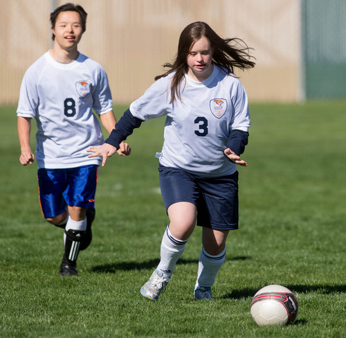 Trent Nelson     The Salt Lake Tribune Brighton's Andy Melville and Kira Hooyer in action vs. Alta High School in Sandy, Wednesday April 23, 2014. In Unified Soccer, high school athletes who have intellectual disabilities team with partners in 5-on-5 games.
