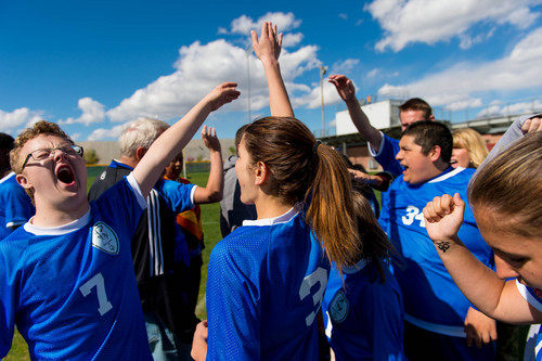 Trent Nelson     The Salt Lake Tribune Bingham's Josh Rothey and teammates high-five after a win over Jordan High School in Sandy, Wednesday April 23, 2014. In Unified Soccer, high school athletes who have intellectual disabilities team with partners in 5-on-5 games.