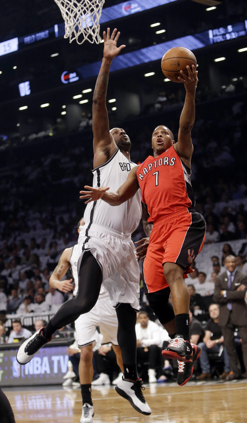 Toronto Raptors' Kyle Lowry (7) drives past Brooklyn Nets' Andray Blatche during the first half of Game 6 of the opening-round NBA basketball playoff series Friday, May 2, 2014, in New York. (AP Photo/Frank Franklin II)