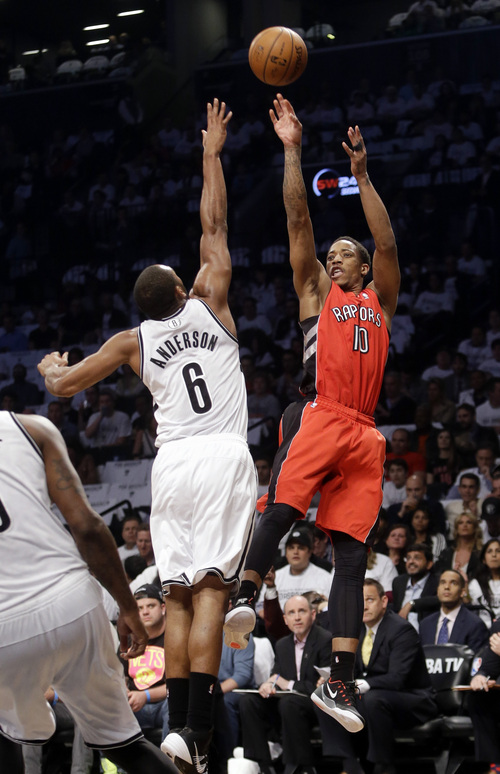 Toronto Raptors' DeMar DeRozan (10) shoots over Brooklyn Nets' Alan Anderson (6) during the first half of Game 6 of the opening-round NBA basketball playoff series Friday, May 2, 2014, in New York. (AP Photo/Frank Franklin II)