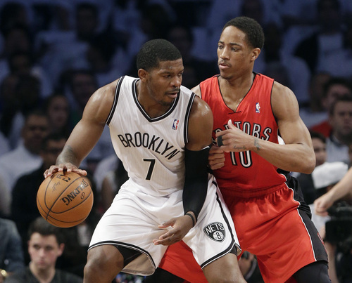 Toronto Raptors' DeMar DeRozan (10) defends Brooklyn Nets' Joe Johnson (7) during the first half of Game 6 of the opening-round NBA basketball playoff series Friday, May 2, 2014, in New York. (AP Photo/Frank Franklin II)