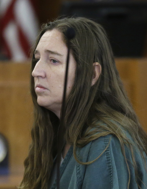 Megan Huntsman, accused of killing six of her babies and storing their bodies in her garage, appears in court Monday, April 28, 2014, in Provo, Utah. Prosecutors have filed six first-degree murder charges against Huntsman. The charges were filed Monday morning shortly before 39-year-old Huntsman appeared in court for the second time. She was informed of the charges during the brief hearing. (AP Photo/Rick Bowmer, Pool)