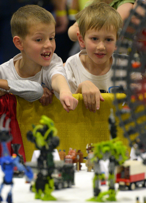 Rick Egan  |  The Salt Lake Tribune Jens Hume 6, and his bother Wesley Hume, 8, check out the BrickSlopes exhibit at the South Towne Expo Center on Saturday, May 3, 2014. The event included LEGO creations from master builders across the U.S. plus a play area for kids with more than 50,000 LEGO bricks.