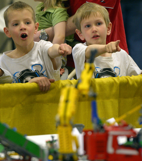 Rick Egan  |  The Salt Lake Tribune  Jens Hume 6, and his bother Wesley Hume, 8, check out the BrickSlopes exhibit at the South Towne Expo Center, Saturday, May 3, 2014. The event included LEGO creations from master builders across the U.S. plus a play area for kids with more than 50,000 LEGO bricks.