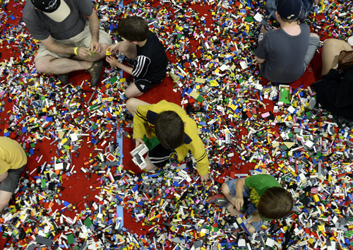 Rick Egan  |  The Salt Lake Tribune Kids play in more than 50,000 LEGO bricks, at the South Towne Expo Center on Saturday, May 3, 2014. The BrickSlopes event included LEGO creations from master builders across the U.S.