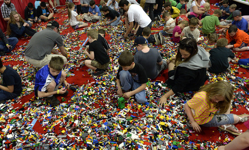 Rick Egan  |  The Salt Lake Tribune  Kids play in more than 50,000 LEGO bricks, at the South Towne Expo Center, Saturday, May 3, 2014. The BrickSlopes event included LEGO creations from master builders across the U.S.