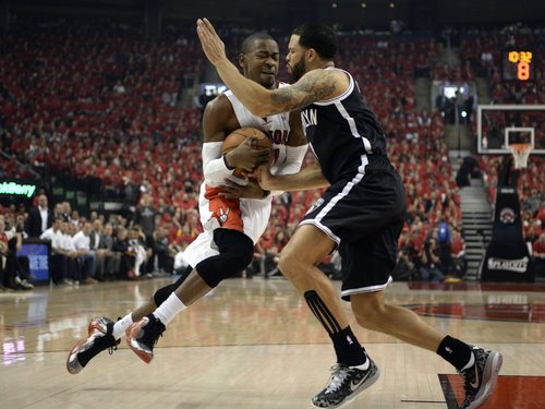 Toronto Raptors' Terrence Ross, left, drives to the net against Brooklyn Nets' Deron Williams during the first half of Game 7 of the opening-round NBA basketball playoff series in Toronto, Sunday, May 4, 2014. (AP Photo/The Canadian Press, Frank Gunn)