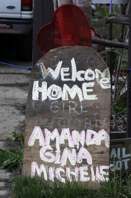 FILE- This Saturday, May 11, 2013 file photo shows a sign resting in front of a home in Cleveland. The list of missing people in Cleveland makes up about one out of every 10 cases in the entire state. Most are found within a few weeks, but there more than 22 people who have been gone for more than a year. (AP Photo/Tony Dejak, File)