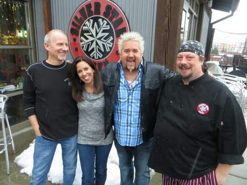 """Courtesy of Lisa Ward Guy Fieri, host of the Food Network show """"Diners, Drive-Ins and Dives,"""" is shown with Lisa and Jeff Ward, owners of The Silver Star Cafe in Park City, and chef Dave Bible."""