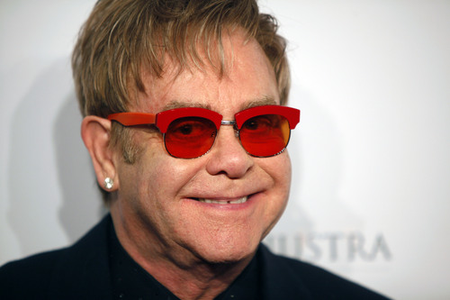 "Elton Elton arrives at the Elton John AIDS Foundation's 12th Annual ""An Enduring Vision"" benefit gala at Cipriani Wall Street on Tuesday, Oct. 15, 2013 in New York. (Photo by Carlo Allegri/Invision/AP)"