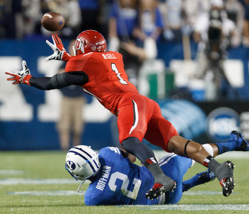 Trent Nelson  |  The Salt Lake Tribune Utah Utes defensive back Keith McGill (1) leaps to intercept a BYU pass and comes up just short in the first quarter as the BYU Cougars host the Utah Utes, college football Saturday, September 21, 2013 at LaVell Edwards Stadium in Provo. Brigham Young Cougars wide receiver Cody Hoffman (2) at bottom.