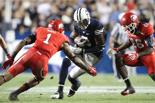 Rick Egan | The Salt Lake Tribune  BYU wide receiver Cody Hoffman (2) is brought down by Utes defensive back Keith McGill (1) and Utes defensive back Ryan Lacy (26) during BYU's game against Utah at Lavell Edwards Stadium in Provo, Utah September 17, 2011.