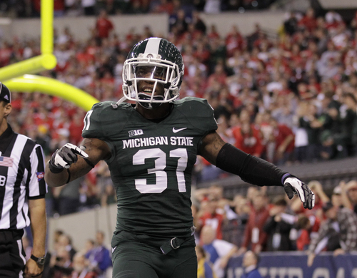Michigan State's Darqueze Dennard (31) reacts during the second half of a Big Ten Conference championship NCAA college football game against Ohio State Saturday, Dec. 7, 2013, in Indianapolis. (AP Photo/AJ Mast)