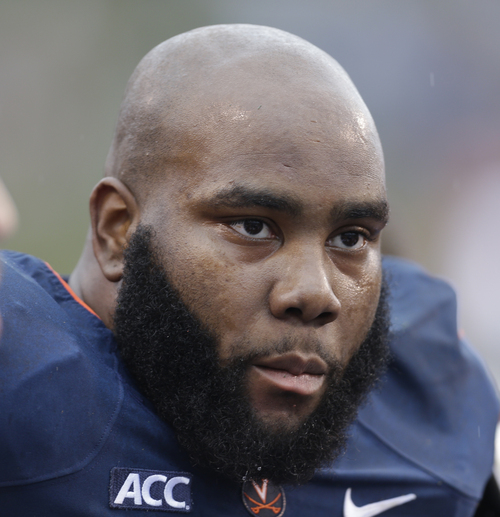 Virginia offensive tackle Morgan Moses (78) listens to coaches during the first half of an NCAA college football game in Charlottesville, Va., Saturday, Sept. 21, 2013. (AP Photo/Steve Helber)