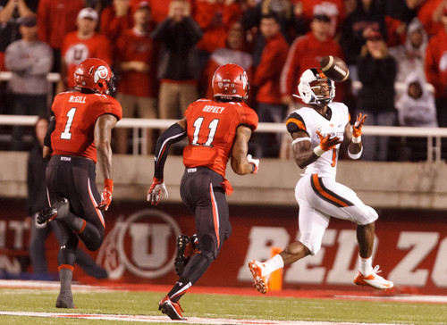 Trent Nelson  |  The Salt Lake Tribune Oregon State Beavers wide receiver Brandin Cooks (7) pulls in a long reception ahead of Utah Utes defensive back Keith McGill (1) and defensive back Davion Orphey (11) as the University of Utah hosts Oregon State, college football at Rice Eccles Stadium Saturday, September 14, 2013 in Salt Lake City.