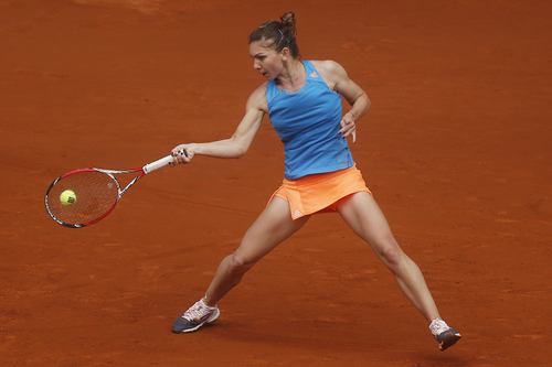 Simona Halep from Romania returns the ball to Lara Arruabarrena from Spain during a Madrid Open tennis tournament match in Madrid, Spain, Wednesday May 7, 2014. (AP Photo/Andres Kudacki)