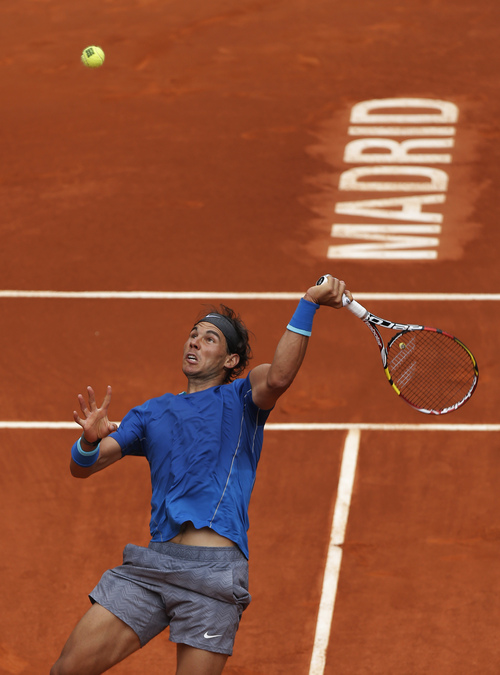 Rafael Nadal from Spain returns the ball during a Madrid Open tennis tournament match against Juan Monaco from Argentina, in Madrid, Spain, Wednesday May 7, 2014. (AP Photo/Andres Kudacki)