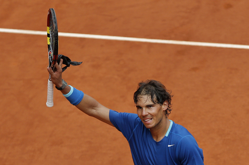 Rafael Nadal from Spain celebrates his victory during a Madrid Open tennis tournament match against Juan Monaco from Argentina, in Madrid, Spain, Wednesday, May 7, 2014. (AP Photo/Andres Kudacki)