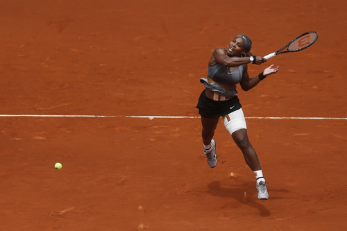 Serena Williams from US returns the ball to Shuai Peng from China during a Madrid Open tennis tournament match in Madrid, Spain, Wednesday, May 7, 2014. (AP Photo/Andres Kudacki)