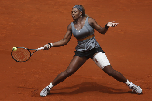 Serena Williams from the US returns the ball during a Madrid Open tennis tournament match against Shuai Peng from China, in Madrid, Spain, Wednesday, May 7, 2014. (AP Photo/Andres Kudacki)