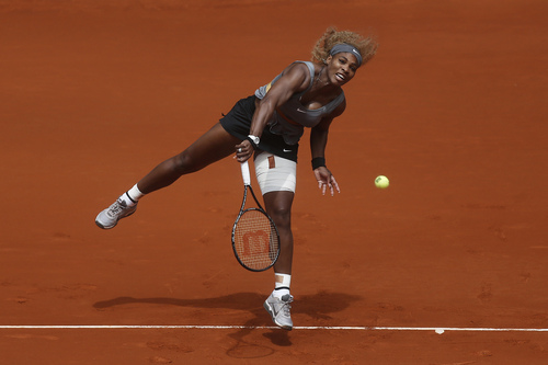 Serena Williams from the US serves during a Madrid Open tennis tournament match against Shuai Peng from China, in Madrid, Spain, Wednesday, May 7, 2014. (AP Photo/Andres Kudacki)