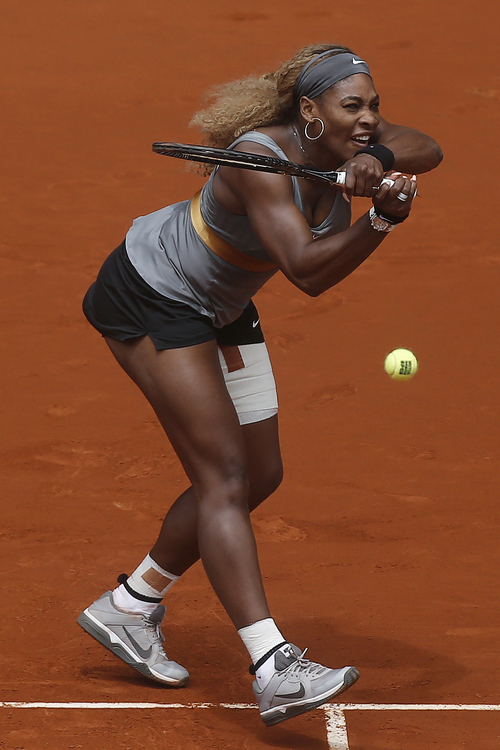 Serena Williams from US returns the ball to Shuai Peng from China during a Madrid Open tennis tournament match, in Madrid, Spain, Wednesday May 7, 2014. (AP Photo/Andres Kudacki)