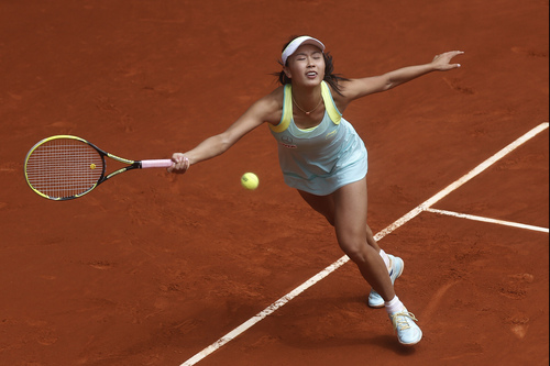 Shuai Peng from China fails to return the ball during a Madrid Open tennis tournament match against Serena Williams from US, in Madrid, Spain, Wednesday, May 7, 2014. (AP Photo/Andres Kudacki)