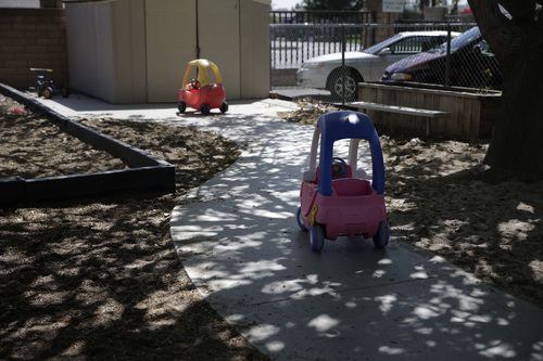 This April 14, 2014 photo shows two toy in the playground at Community Day Preschool of Garden Grove, in Garden Grove, Calif. According to the school's executive director Sue Puisis, the enrollment at the preschool has dropped by more than 50 percent since 2008. The financial crisis that followed the collapse of U.S. investment bank Lehman Brothers in 2008 sent birth rates tumbling around the world as couples found themselves too short of money or too fearful about their finances to have children. Six years later, birth rates haven't bounced back. (AP Photo/Jae C. Hong)
