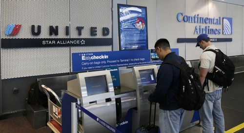 FILE - In this May 3, 2010 file photo, passengers check-in for their flight in Chicago's O'Hare International Airport.  A bipartisan group of 33 lawmakers led by House Transportation and Infrastructure Committee Chairman Bill Shuster, R-Pa., is backing a bill that would allow airlines to return to their old way of doing things, which is to emphasize in ads the base airfare, the amount airlines charge passengers to fly, and reveal the full price including taxes and fees separately.   (AP Photo/Charles Rex Arbogast)