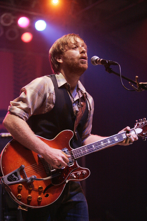 In this June 11, 2010 file photo, Dan Auerbach of the band The Black Keys perform at the Bonnaroo Music and Arts Festival in Manchester, Tenn. The Black Keys have headed south leaving Akron for the Music City, where singer-guitarist Dan Auerbach and drummer Patrick Carney recently bought homes. The duo considered a short list of finalists before settling on Nashville. (AP Photo/Jeff Christensen, File)