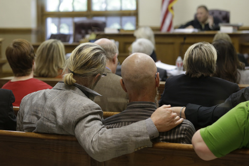 "FIle - In this  Thursday, April 17, 2014, spectators watch proceedings in Circuit Judge Chris Piazza's courtroom at the Pulaski County Court House in Little Rock, Ark.  A judge on Friday, May 9, 2014,  struck down Arkansas' ban on same-sex marriage, saying the state has ""no rational reason"" for preventing gay couples from marrying. (AP Photo/Danny Johnston)"