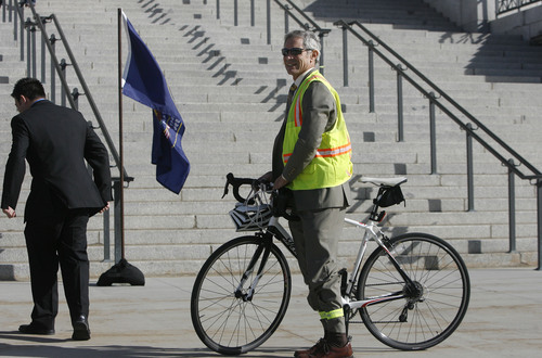"Scott Sommerdorf   |  Tribune file photo Salt Lake City Mayor Ralph Becker arrives on his bike to support the ""Count My Vote"" effort on the south steps of the State Capitol building, Wednesday, September 18, 2013."