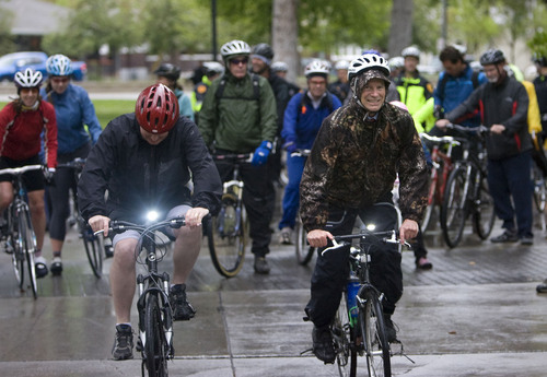 Al Hartmann  |  Tribune file photo Salt Lake County Mayor Peter Corroon, left, and Salt Lake City Mayor Ralph becker lead a group of  bike riders from Liberty Park to Salt Lake County Government Center  and the City County Building for Bike To Work Day.