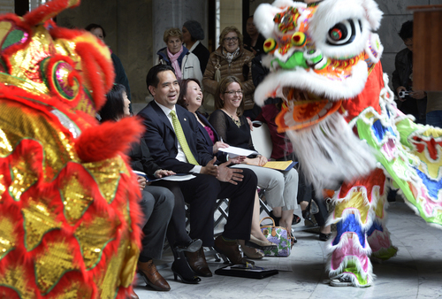 Scott Sommerdorf   |  The Salt Lake Tribune Utah Attorney General Sean Reyes watches the Jung Hing Lion Dance Club lion dancers perform in the State Capitol rotunda prior to the event where representatives from Utah Gov. Gary Herbert's office will join other elected officials, including visitors from China's Guandong Province to recognize and honor the role played by primarily Chinese laborers in constructing and completing America's first transcontinental railroad, Friday, May 9, 2014. The event is part of the official commemoration of the May 10, 1869, driving of the Golden Spike that marked the connection of the Union and Central Pacific Railroads at Promontory Point, Utah.
