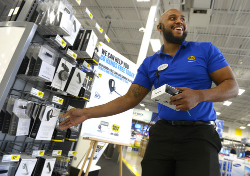 Leah Hogsten  |  The Salt Lake Tribune Best Buy special sales manager Cedric Reeves stocks bluetooth handsfree devices on the store shelves, Thursday, May 8, 2014. A new law that bans manipulating cell phones and similar devices while driving,including no texting or dialing, goes into effect Tuesday May 13, 2014.