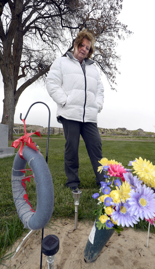 Al Hartmann  |  The Salt Lake Tribune Midwife Donna Young looks at a grave marker of a stillborn child in Rock Point Cemetery in Maeser just north of Vernal.  She started noticing a higher than usual amounts of stillborn and newborn deaths in the area the past few years.  One corner of the cemetery has several small markers for stillborn and newborn  deaths.     The TriCounty Health Department is holding a public meeting Wednesday May 7 to investigate the uptick in stillbirths and newborn deaths in the area. Environmentalists believe there's a connection to air pollution from oil and gas drilling.