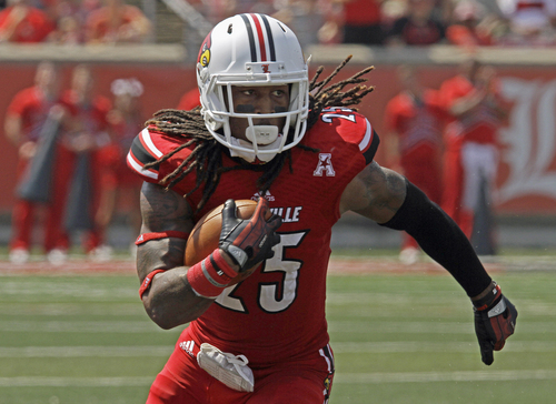 Louisville's Calvin Pryor turns and runs after picking off a pass against Eastern Kentucky in their NCAA college football game in Louisville, Ky., Saturday, Sept. 7, 2013. Louisville beat Eastern Kentucky 44-7.  (AP Photo/Garry Jones)