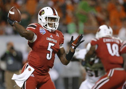 John Raoux | The Associated Press Louisville quarterback Teddy Bridgewater throws a pass against Miami during the first half of the Russell Athletic Bowl NCAA college football game in Orlando, Fla., Saturday, Dec. 28, 2013. (AP Photo/John Raoux)