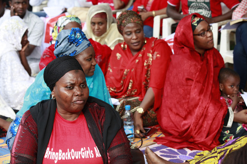 """Women attend a rally calling on the Government to rescue the school girls kidnapped from the Chibok Government secondary school, in Abuja, Nigeria, Saturday May 10, 2014. The president of Nigeria for weeks refused international help to search for more than 300 girls abducted from a school by Islamic extremists, one in a series of missteps that have led to growing international outrage against the government. The waiting has left parents in agony, especially since they fear some of their daughters have been forced into marriage with their abductors for a nominal bride price of $12. Boko Haram leader Abubakar Shekau called the girls slaves in a video this week and vowed to sell them. """"For a good 11 days, our daughters were sitting in one place,"""" said Enoch Mark, the anguished father of two girls abducted from the Chibok Government Girls Secondary School. """"They camped them near Chibok, not more than 30 kilometers, and no help in hand. For a good 11 days."""" (AP Photo/Sunday Alamba)"""